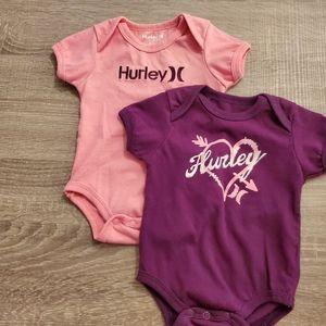 Bundle of 2 Hurley baby body suits.